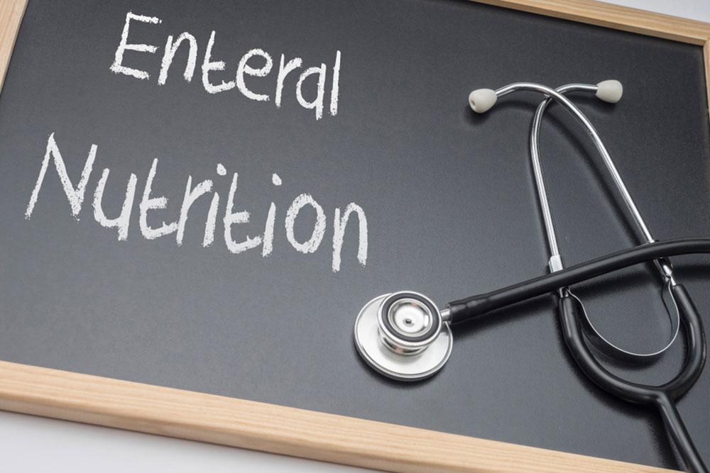 Enteral nutrition written on a blackboard, conceptual image, horizontal composition