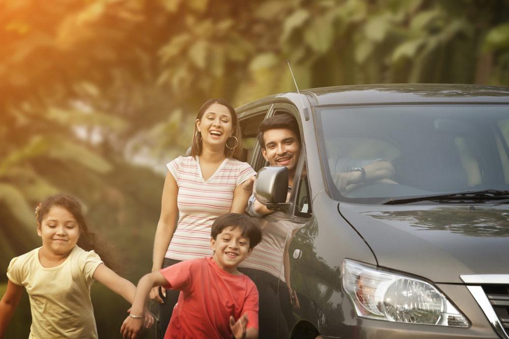 Happy children running from car